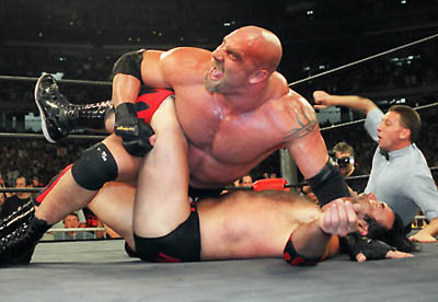 WCW Heavyweight Champion Bill Goldberg puts Scott Hall to the mat During a WCW match July 6, 1998 in Atlanta. Goldberg, a football star at the University of Georgia Whose pro career was ended by injury, has become WCW's most popular wrestler. Goldberg - who is Jewish - says he has not heard many racist taunts, or felt pressure from organizers to change His Name. (AP Photo / Erik S. Lesser)