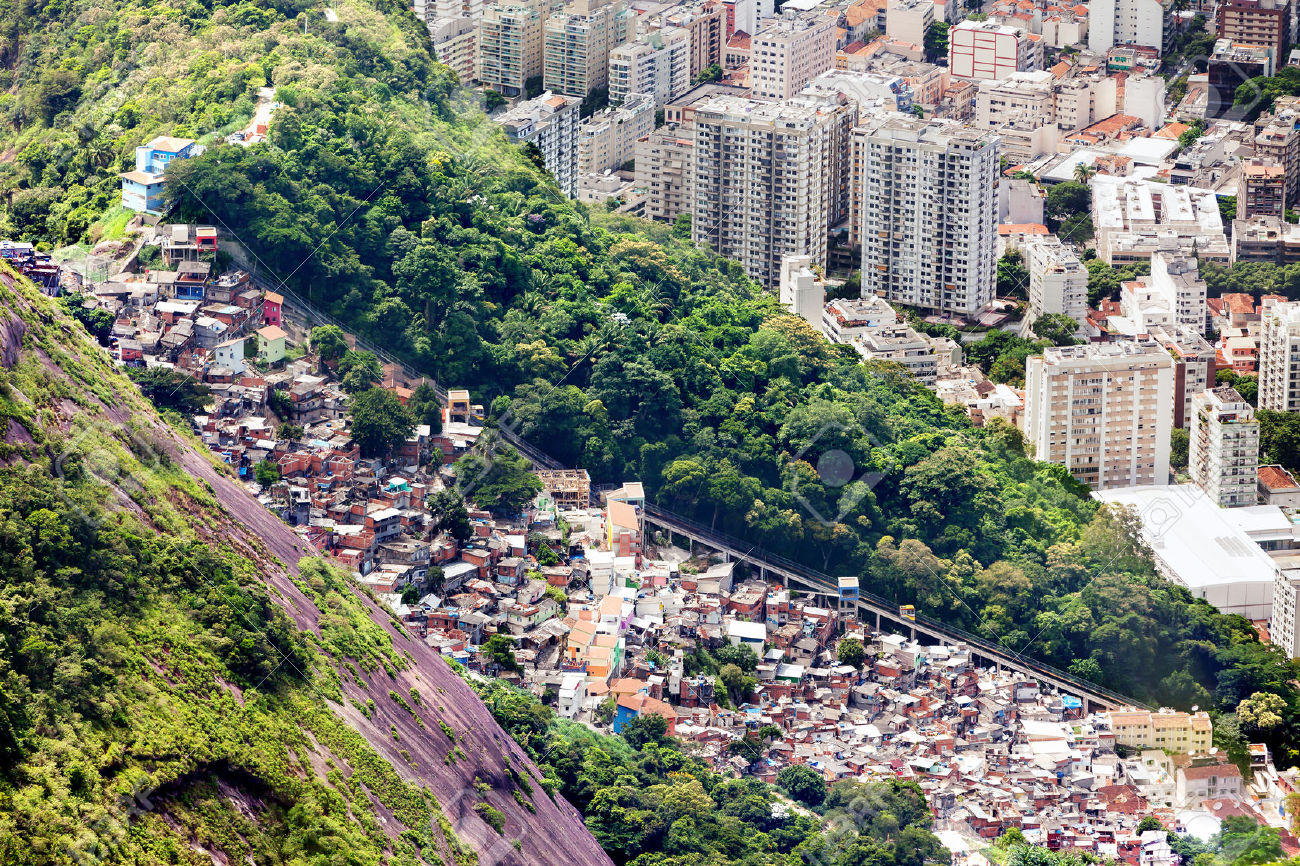 34315766-aerial-view-of-favela-and-skyscrapers-a-Rio-de-Janeiro-Brazil-Archive-Photo